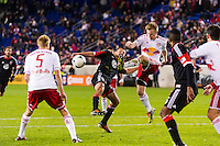 Dax McCarty (11) of the New York Red Bulls clears a ball from in front of the Red Bulls goal. D. C. United defeated the New York Red Bulls 1-0 (2-1 in aggregate) during the second leg of the MLS Eastern Conference Semifinals at Red Bull Arena in Harrison, NJ, on November 8, 2012.