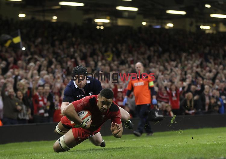 Wales number 8 Taulupe Faletau dives over to score in the corner despite the efforts of Alasdair Dickinson to stop him.<br /> RBS 6 Nations 2014<br /> Wales v Scotland<br /> Millennium Stadium<br /> <br /> 15.03.14<br /> <br /> ©Steve Pope-SPORTINGWALES