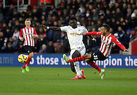 Pictured L-R: Bafetimbi Gomis of Swansea challenged by Ryan Bertrand of Southampton Sunday 01 February 2015<br />