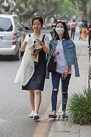 Suzhou, Jiangsu, China.  Young Woman Using Breathing Mask.