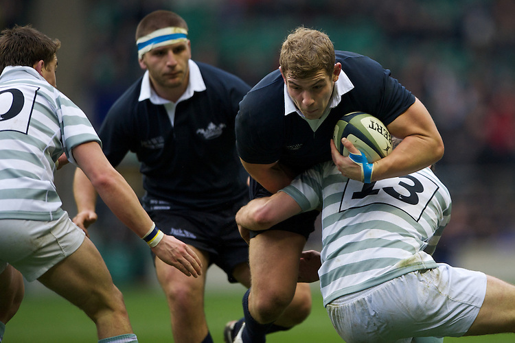 Bob Baker of Oxford University is tackled by Danny Holmes of Cambridge University during the 131st Varsity Match between Oxford University and Cambridge University at Twickenham on Thursday 06 December 2012 (Photo by Rob Munro)