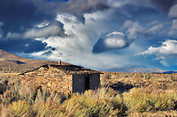 Historic stone cabin with storm and steens mountain. Fields, Oregon