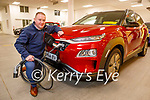 Marcus O'Shea from Adams of Tralee standing at an electric car at the showroom on Monday.