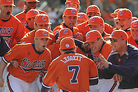 Head coach Jack Leggett (7) jumps into a pile of his players prior to a game between the Charlotte 49ers and Clemson Tigers Feb. 20, 2009, at Doug Kingsmore Stadium in Clemson, S.C. (Photo by: Tom Priddy/Four Seam Images)