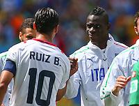 Mario Balotelli of Italy shakes hands with Bryan Ruiz of Costa Rica