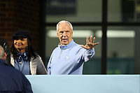 CHAPEL HILL, NC - NOVEMBER 02: Men's Basketball head coach Roy Williams of the University of North Carolina waives to a fan during a game between University of Virginia and University of North Carolina at Kenan Memorial Stadium on November 02, 2019 in Chapel Hill, North Carolina.
