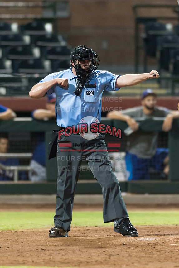 Home plate umpire Ethan Gorsak calls a batter out on strikes during an Arizona League game between the AZL Rangers and the AZL Giants Black at Scottsdale Stadium on August 4, 2018 in Scottsdale, Arizona. The AZL Giants Black defeated the AZL Rangers by a score of 6-3 in the second game of a doubleheader. (Zachary Lucy/Four Seam Images)
