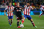 Atletico de Madrid´s Arda Turan (R) and Bayer 04 Leverkusen´s Spahic during the UEFA Champions League round of 16 second leg match between Atletico de Madrid and Bayer 04 Leverkusen at Vicente Calderon stadium in Madrid, Spain. March 17, 2015. (ALTERPHOTOS/Victor Blanco)