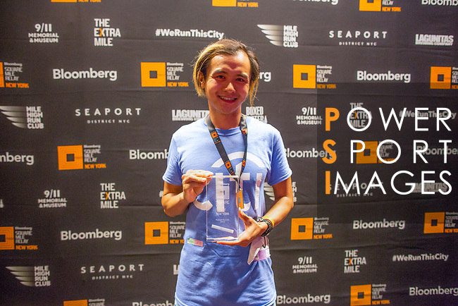 The Extra Mile 2018 - Fastest runner poses with his trophy after winning the New York race on 3 May 2018, in New York, USA. Photo by Fernando Alonso/ Power Sport Images