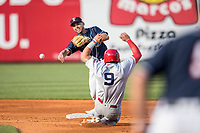 Toledo Mud Hens second baseman Omar Infante (49) turns a double play as Louisville Bats baserunner Sebastian Elizalde (9) slides into second during the International League baseball game on May 17, 2017 at Fifth Third Field in Toledo, Ohio. Toledo defeated Louisville 16-2. (Andrew Woolley/Four Seam Images)
