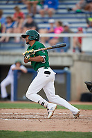 Beloit Snappers second baseman Jesus Lage (12) follows through on a swing during a game against the Dayton Dragons on July 22, 2018 at Pohlman Field in Beloit, Wisconsin.  Dayton defeated Beloit 2-1.  (Mike Janes/Four Seam Images)