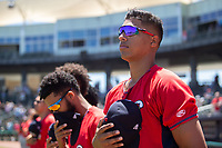 Springfield Cardinals pitcher Johan Oviedo (44) and teammates face the American flag during the playing of the national anthem on May 19, 2019, at Arvest Ballpark in Springdale, Arkansas. (Jason Ivester/Four Seam Images)