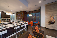 Stock photo of dining area and kitchen in luxurious modern home