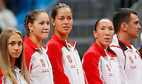 Serbia's players, from left, Aleksandra Krunic, Bojana Jovanovska, Ana Ivanovic, Jelena Jankovic and team captain Dejan Vranes, listen national anthem, during the World Group play-off Fed Cup match in Bratislava, Slovakia, Saturday, Apr. 16, 2011. (Srdjan Stevanovic/Starsportphoto ©).