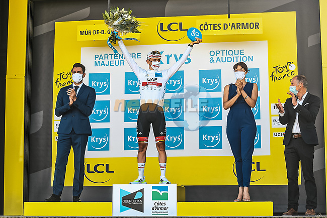 Tadej Pogacar (SLO) UAE Team Emirates retains the young riders White Jersey at the end of Stage 2 of the 2021 Tour de France, running 183.5km from Perros-Guirec to Mur-de-Bretagne Guerledan, France. 27th June 2021.  <br /> Picture: A.S.O./Charly Lopez   Cyclefile<br /> <br /> All photos usage must carry mandatory copyright credit (© Cyclefile   A.S.O./Charly Lopez)