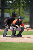 Umpire Jaylen Goodman and GCL Astros catcher Tyler Krabbe (56) during a Gulf Coast League game against the GCL Nationals on August 9, 2019 at FITTEAM Ballpark of the Palm Beaches training complex in Palm Beach, Florida.  GCL Nationals defeated the GCL Astros 8-2.  (Mike Janes/Four Seam Images)