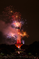 The UT Tower is painted burnt orange with and colorful explosive fireworks display to celebrate the 2017 graduation ceremony at the University of Texas campus in downtown Austin, Texas.