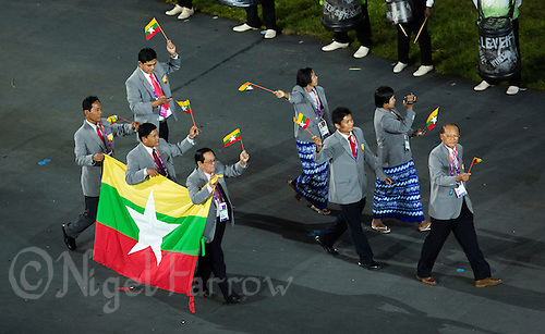 27 JUL 2012 - LONDON, GBR - Competitors from Myanmar (MYA) walk around the Olympic Stadium during the Opening Ceremony of the London 2012 Olympic Games in Stratford, London, Great Britain .(PHOTO (C) 2012 NIGEL FARROW)