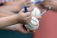 Memphis Redbirds young fan holding out a baseball to get signed before a game against the Oklahoma City RedHawks on May 23, 2014 at AutoZone Park in Memphis, Tennessee.  Oklahoma City defeated Memphis 12-10.  (Mike Janes/Four Seam Images)
