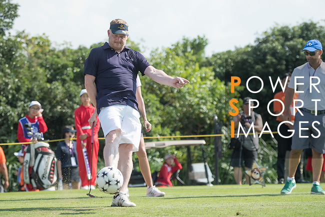 David May kicks a football at the 14th hole during the World Celebrity Pro-Am 2016 Mission Hills China Golf Tournament on 22 October 2016, in Haikou, China. Photo by Weixiang Lim / Power Sport Images