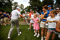 Phil Mickelson interacts with fans during the Quail Hollow Championship 2009 Pro-Am in Charlotte, North Carolina. The Pro-Am is held as part of the professional championship, formerly called the Wachovia Championship, which is a top event on the PGA Tour, attracting such popular golf icons as Tiger Woods, Vijay Singh and Bubba Watson.