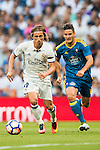 Luka Modric of Real Madrid runs past Nemanja Radoja of RC Celta de Vigo during their La Liga match at the Santiago Bernabeu Stadium between Real Madrid and RC Celta de Vigo on 27 August 2016 in Madrid, Spain. Photo by Diego Gonzalez Souto / Power Sport Images