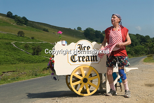 Man selling home made ice cream on the south side of River Warfe bank nr Hubberholm. Langstrothdale valley in the Yorkshire Dales National Park. Warfedale. North Yorkshire. He is trying top catch the attention of some cyclists who passing. Roger Ingham MBE know as Mr Sport in Skipton his home town.