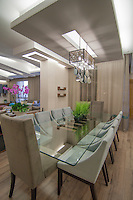 Modern interiors of living and dinning rooms for a private villa. Architecture and interior design and furnishing.