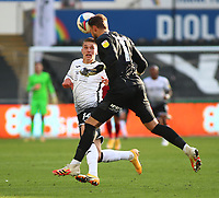 17th October 2020; Liberty Stadium, Swansea, Glamorgan, Wales; English Football League Championship Football, Swansea City versus Huddersfield Town; Ben Hamer of Huddersfield Town comes out of his area to head the ball clear as Viktor Gyokeres of Swansea City closes in