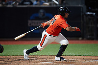 Christopher Burgess (24) of the Aberdeen IronBirds follows through on his swing against the Hudson Valley Renegades at Leidos Field at Ripken Stadium on July 23, 2021, in Aberdeen, MD. (Brian Westerholt/Four Seam Images)