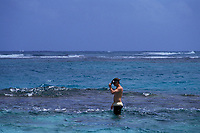 snorkeler standing on coral reef, Cancun, Mexico, Caribbean Sea, Atlantic