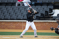 Ben Breazeale (9) of the Wake Forest Demon Deacons at bat against the Appalachian State Mountaineers at Wake Forest Baseball Park on February 13, 2015 in Winston-Salem, North Carolina.  The Mountaineers defeated the Demon Deacons 10-1.  (Brian Westerholt/Four Seam Images)