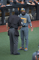 Tennessee Volunteers head coach Tony Vitello (22) discusses a call with home plate umpire David Pritchett during the game against the Charlotte 49ers at Hayes Stadium on March 9, 2021 in Charlotte, North Carolina. The 49ers defeated the Volunteers 9-0. (Brian Westerholt/Four Seam Images)
