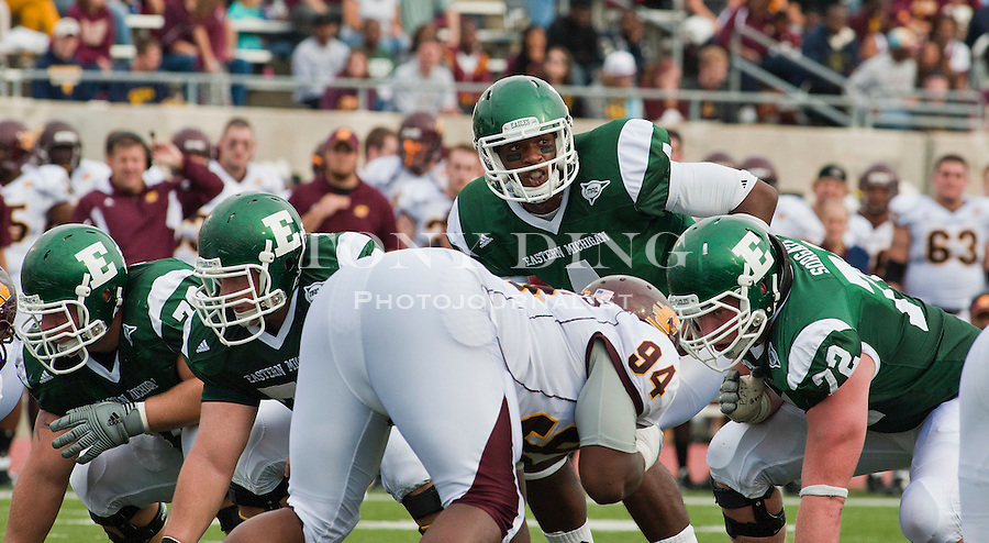 Eastern Michigan quarterback Devontae Payne (4) shouts from behind his offensive linemen before a snap in the second quarter of an NCAA college football game with Central Michigan, Saturday, Sept. 18, 2010, in Ypsilanti, Mich. (AP Photo/Tony Ding)