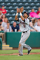 Renny Osuna (9) of the Arkansas Travelers catches a ball in the infield during a game against the Springfield Cardinals at Hammons Field on June 13, 2012 in Springfield, Missouri. (David Welker/Four Seam Images)