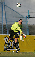 09 February, 2005. USMNT goalkeeper Kasey Keller throws the ball forward during the World Cup qualifier at Queen's Park Oval in Port of Spain, Trinidad and Tobago.  The USMNT defended Trinidad and Tobago 2-1.
