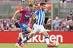 FC Barcelona's Frenkie De Jong (l) and Antoine Griezmann (c) and Real Sociedad's Mikel Merino during La Liga match. August 15, 2021. (ALTERPHOTOS/Acero)