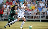 Allison Falk(white) moves past Eniola Aluko..Saint Louis Athletica were defeated 2-1 by LA Sol, at Anheuser-Busch Soccer Park, Fenton, Missouri.