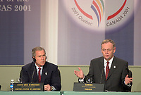 April 22,  2001, Quebecl, Quebec, Canada<br /> <br /> George W, Bush, United States of Americas Presidennt (R)  listen while <br /> <br /> Jean Chretien, Canada's Prime Minister (L) speak at the closing press conference of the Summit of the Americas , April 22, 2001 in Quebec City, CANADA.<br /> <br /> Both leader agreed to meet before the upcoming G-8 meeting this spring in Alberta, Canada.