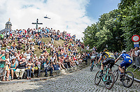Timo Roosen (NED/Lotto Jumbo) and Philippe Gilbert (BEL/Quick Step Floors) up the infamous Kapelmuur. <br /> <br /> Binckbank Tour 2017 (UCI World Tour)<br /> Stage 7: Essen (BE) > Geraardsbergen (BE) 191km