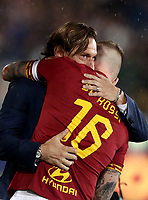 Football, Serie A: AS Roma - Parma, Olympic stadium, Rome, May 26, 2019. <br /> Roma's Daniele De Rossi (r) is congratulated by former captain Francesco Totti (l) during his farewell to Roma after 18 years at his home-town club at the end of the Italian Serie A football match between Roma and Parma at Olympic stadium in Rome, on May 26, 2019.<br /> UPDATE IMAGES PRESS/Isabella Bonotto
