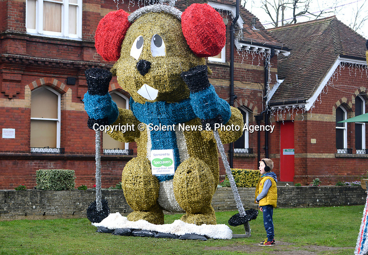 PARENTAL CONSENT GIVEN<br /> <br /> Pictured: Hugo Kendall-Heally, 8, stands in awe of Marmite, one of the marmots on display at the top of Alton High Street.<br /> <br /> A council which infuriated residents of an affluent market town by replacing the traditional Christmas tree with a giant skiing marmot is set to provoke fury again - by installing TWO of them this year.<br /> <br /> The most controversial festive illumination of 2019 is poised to cause double trouble this time as the two 16 foot models are lit up by thousands of LEDs.<br /> <br /> Last December the installation of a single 'embarrassing' marmot in Alton, Hants sparked arguments, with many locals angry at the council's decision.  SEE OUR COPY FOR FULL DETAILS.<br /> <br /> © Ewan Galvin/Solent News & Photo Agency<br /> UK +44 (0) 2380 458800