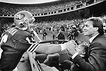 Joe Montana greets Dwight Clark during a halftime ceremony honoring Clark, and retiring the wide receiver's jersey. Montana played 43 49ers games without Clark before moving to Kansas City. Dec. 11, 1988.