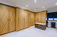 BNPS.co.uk (01202) 558833. <br /> Pic: TailorMade/BNPS<br /> <br /> Pictured: 'His' dressing room. <br /> <br /> A multi-millionaire is hoping to have a shot at selling his luxury mansion - by throwing a hi-tech golf simulator into the deal.<br />  <br /> Golf-loving Barry Bester put the waterfront property on Sandbanks, Dorset, on the market for £11m last year.<br />  <br /> He is now offering his £40,000 state-of-the-art simulator he has had built on the grounds with the sale.