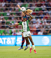 AUSTIN, TX - JUNE 16: Samantha Mewis #3 of the USWNT goes up for a header with Rasheedat Ajibade #15 of Nigeria during a game between Nigeria and USWNT at Q2 Stadium on June 16, 2021 in Austin, Texas.