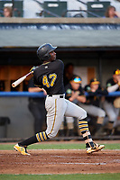 Bristol Pirates third baseman Sherten Apostel (47) follows through on a swing during a game against the Bluefield Blue Jays on July 26, 2018 at Bowen Field in Bluefield, Virginia.  Bristol defeated Bluefield 7-6.  (Mike Janes/Four Seam Images)