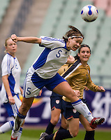 Finland's (5) Tiina Salmen heads a ball in the box during the Four Nations Tournament in  Guangzhou, China.  The US defeated Finland, 4-1.