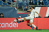 FOXBOROUGH, MA - MAY 1: Carles Gil #22 of New England Revolution and Santiago Sosa #5 of Atlanta United FC battle for the ball during a game between Atlanta United FC and New England Revolution at Gillette Stadium on May 1, 2021 in Foxborough, Massachusetts.
