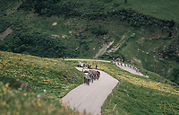 the yellow jersey peloton & a dropped group of riders caught in 1 frame<br /> <br /> Stage 7: Moûtiers > Saint-Gervais Mont Blanc (129km)<br /> 70th Critérium du Dauphiné 2018 (2.UWT)