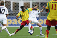 Marcus Julien (left) and Clarence Goodson (3) battle for the ball. USA defeated Grenada 4-0 during the First Round of the 2009 CONCACAF Gold Cup at Qwest Field in Seattle, Washington on July 4, 2009.